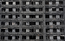 Extensive damage is seen to the Grenfell Tower block which was destroyed in a fire disaster, in north Kensington, West London.