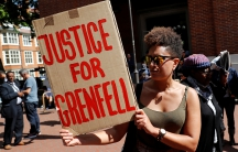 A protester outside Kensington and Chelsea Town Hall. Anger has been growing over the authorities' handling of the tragedy at Grenfell Tower.