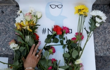 An attendee leaves flowers for Nabra Hassanen, a teenage Muslim girl killed by a bat-wielding motorist near a Virginia mosque, during a vigil in New York City, U.S. June 20, 2017.