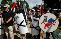 White supremacists stand behind their shields at a rally in Charlottesville, Virginia, U.S., August 12, 2017.