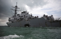 A gash can be seen in the destroyer, the USS John S. McCain, after a collision with civilian ship on Monday