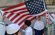 Children play near an American flag during the annual Muslim Day Parade in New York City.