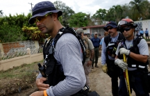 "Members of the Federal Emergency Management Agency (FEMA) ""Urban Search and Rescue"" team conduct a search operation in an area hit by Hurricane Maria in Yauco, Puerto Rico on September 25, 2017."