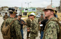 U.S. Marines and Navy corpsmen attached to the 26th Marine Expeditionary Unit and Sailors assigned to Amphibious Construction Battalion 2 speak with local civilian employees during an assessment of Hospital Oriente's medical and operational needs as part
