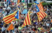 People hold Esteladas (Catalan separatist flags) as they wait for a closing rally in favour of the banned October 1 independence referendum in Barcelona, Spain.