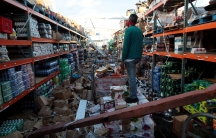 A man stands inside of a destroyed supermarket by Hurricane Maria in Salinas, Puerto Rico, Sept. 29, 2017.