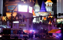 Las Vegas Metro Police and medical workers stage in the intersection of Tropicana Avenue and Las Vegas Boulevard South after a mass shooting