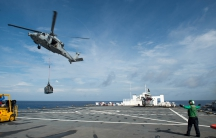 An MH-60S Sea Hawk helicopter delivers cargo to the hospital ship USNS Comfort as the ship is underway in support of humanitarian relief operations to help those affected by Hurricane Maria in Puerto Rico on October 1, 2017.