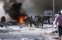 Somali government forces evacuate an injured colleague from the scene of an explosion at Kilometer 4 street in the Hodan district of Mogadishu, Somalia, on Oct. 14, 2017.