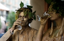 Performers drink wine during a wine festival in Tbilisi, Georgia, Oct. 15, 2017.