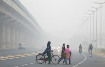People cross the road in Delhi, India, during the height of the most recent air pollution crisis, Nov. 7, 2017.