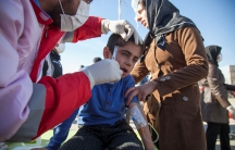 A wounded boy is treated following an earthquake in Sarpol-e Zahab county in Kermanshah, Iran.