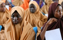 Some of the newly-released Dapchi schoolgirls wait to board a plane at the air force base in Maiduguri.