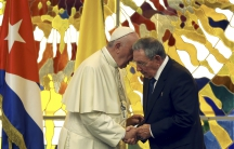 Pope Francis and Cuba's President Raul Castro confer in Havana on Sunday.