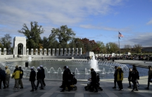 World War II veterans walk to a wreath laying ceremony at the National World War II Memorial on Veteran's Day to pay tribute to the more than 16 million men and women who served with U.S. armed forces during World War II.