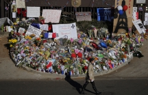 Flowers and expressions of sympathy, at the entrance to the French embassy in Washington.