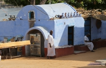 A resident looks on from his traditional house at the Nubian Gharb Suheil village, near Aswan, southern Egypt.