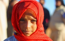 An internally displaced girl poses at a makeshift refugee camp in Sinjar town, in Idlib province, Syria November 20, 2015.