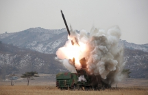 A new multiple launch rocket system is test fired in this undated photo released by North Korea's Korean Central News Agency (KCNA) in Pyongyang March 4, 2016.
