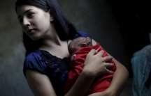 Ianka Mikaelle Barbosa, 18, with Sophia, 18 days old, who was born with microcephaly, at her home in Campina Grande, Brazil.