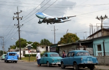 Air Force One carrying US President Barack Obama and his family flies over a neighborhood of Havana as it approaches the runway to land at Havana's international airport, March 20, 2016.