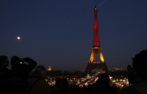 The Eiffel Tower is seen with the black, yellow and red colors of the Belgian flag in tribute to the victims of Tuesday's Brussels bomb attacks, in Paris, France, March 22, 2016.