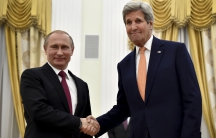 Russian President Vladimir Putin shakes hands with U.S. Secretary of State John Kerry at the Kremlin in Moscow, Russia.