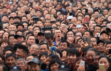 Spectators react as they watch a performance during a local martial arts cultural festival in  Zhejiang province.