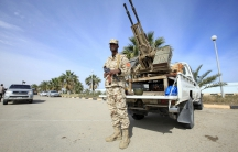 A member of the force assigned to protect Libya's unity government stands on a road leading to new authority's offices in Tripoli, Libya on March 31.