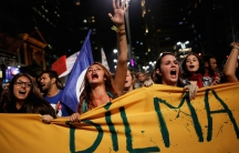 Women shout slogans during a protest against Brazil's interim President Michel Temer and in support of suspended President Dilma Rousseff on Paulista Avenue in Sao Paulo, Brazil, on May 17.