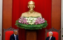 President Obama, in Hanoi, meets with Vietnam's Communist Party chief under a statue of Ho Chi Minh
