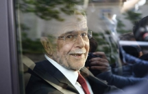 ​Left-wing independent candidate Alexander Van der Bellen smiles out of the window of a car after winning Austrian presidential election in Vienna, Austria,