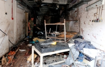 A Syrian Army soldier inspects a damaged emergency room inside National Hospital after explosions hit the Syrian city of Jableh in May.