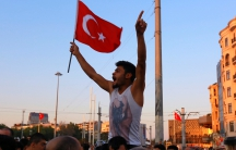 A man waves a Turkish flag at Taksim Square in Istanbul on July 16 after a coup attempt.