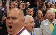 faces in crowd yelling, close up image