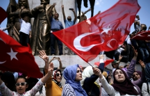Supporters of Turkish President Tayyip Erdogan shout slogans and wave Turkish national flags during a pro-government demonstration in Sarachane park in Istanbul, Turkey, July 19, 2016.