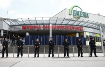Police stand guard outside the Olympia shopping mall, where last week's shooting rampage started, in Munich, Germany July 23, 2016
