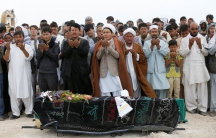 People perform prayers at the funeral for one of the victims of yesterday's suicide attack in Kabul, Afghanistan July 24, 2016.