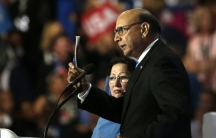 Khizr Khan, who's son Humayun was killed serving in the US Army ten years after September 11, 2001, challenges Republican presidential nominee Donald Trump to read his copy of the U.S. Constitution at the DNC, July 28, 2016.
