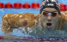 Michael Phelps of the US is seen with a red cupping mark on his shoulder as he competes in the Men's 4 x 100m Freestyle Relay Final at the 2016 Rio Olympics in Rio de Janeiro, Brazil August 7, 2016. . REUTERS/Dominic Ebenbichler