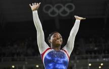Simone Biles of USA celebrates winning gold in the women's individual all-around final.