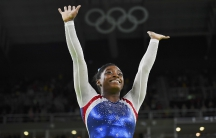 Simone Biles of USA celebrates winning gold in the women's individual all-around final.