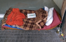 """A make-shift bed of a homeless person, with a sign on top that reads """"I'll be right back,"""" in Buenos Aires, Argentina, on Sept. 11."""