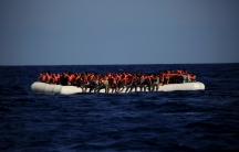 An overcrowded dinghy with migrants from different African countries is seen after members of the German NGO Jugend Rettet guided them towards the Iuventa vessel during a rescue operation, off the Libyan coast in the Mediterranean Sea September 21, 2016.