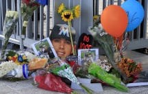 A memorial of flowers and photos are placed outside a gate at Marlins Park in honor of Miami Marlins starting pitcher Jose Fernandez who was killed in a boating accident.