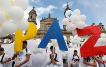 Colombians gather in Bogota's Bolivar Square, to mark the signing of a historic peace deal with the FARC rebels.