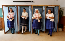 Hungarian women leave voting booths at a polling station during a referendum on European Union migrant quotas in Veresegyhaz, Hungary, on Oct. 2.
