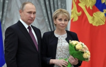 Russia's President Vladimir Putin (L) and head of 'Fair Aid' fund Elizaveta Glinka attend a state awarding ceremony to acknowledge charity and human rights activists at the Kremlin in Moscow, Russia, December 8, 2016.