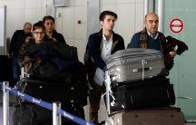 Fuad Sharef Suleman and his family push their belongings after returning to Iraq from Egypt