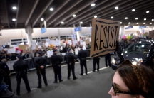 """A demonstrator holds a """"resist"""" sign during anti-Donald Trump travel ban protests outside Philadelphia International Airport in Philadelphia, Pennsylvania, U.S., January 29, 2017."""